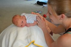 Your newborn is used to lots of movement in the womb but now it's time to start experiencing movement out in the world - without being so curled up and with the benefit of vision. Here's a simple way to introduce movement in the earliest weeks of life. Infant Activities, Activities For Kids, Baby Hacks, Baby Tips, Baby Swings, Baby Coming, Tummy Time, Baby Play, Sensory Play