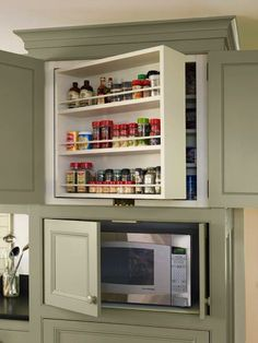organized pantry and kitchen space. kitchen cabinets with swing out shelves and microwave storage, whole house remodel farmhouse addition Farmhouse Kitchen Cabinets, Kitchen Cabinetry, Kitchen Redo, Kitchen Storage, Kitchen Ideas, Kitchen Organization, Cheap Kitchen, Kitchen Modern, Kitchen Designs