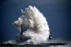 MONSTER FROM THE DEEP ..A huge wave batters Seaham Lighthouse on the North East coast of England during an early evening storm.