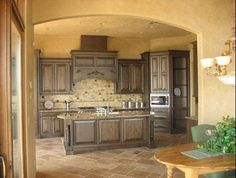 The Natural and Earthy Feel of Tuscan Kitchen - Like the backsplash