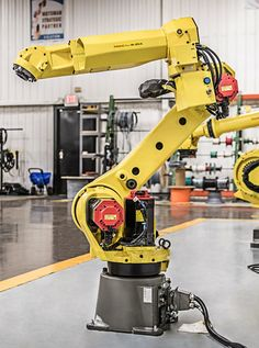 FANUC robots are bought and sold at RobotWorx. New and reconditioned FANUC robots are available. Mechanical Arm, Industrial Robots, Construction Machines, Robot Arm, Robot Design, Artificial Intelligence, Elevator, Akira, Inktober