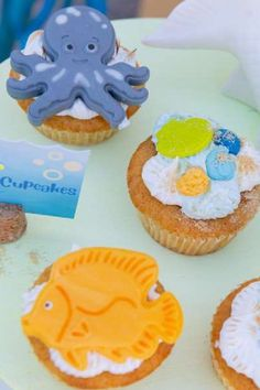 Take a look at the fun mix of cupcakes with under the sea-inspired fondant toppers at this under the sea birthday party See more party ideas and share yours at CatchMyParty.com #catchmyparty #partyideas #4favoritepartiesoftheweek #undertheseacupcakes #underthesea #undertheseaparty #boybirthdayparty