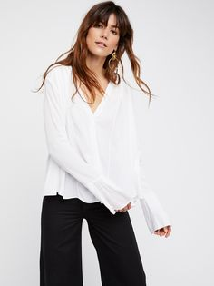 Only For You Top | With a true femme feel, this long sleeve top features an effortless flowy shape and a lightweight, semi-sheer fabrication. V-neckline with hidden front button closures. Bell shaped sleeve cuffs add a retro-inspired detail.