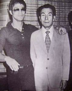 "Bruce Lee and Shih Kien in Enter the Dragon in which he played ""Han"", a one-handed triad boss who is highly skilled in martial arts. His character had a final showdown with Lee's character in the ending climax of the film."