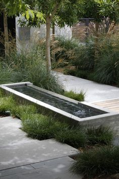 Mark-Tessier-pacific-palisades-garden-poured-concrete-fountain-path-pavers                                                                                                                                                                                 More