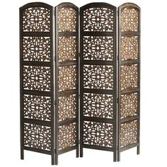 Handcrafted in India, this screen's specialty is versatility. With intricate hand-carved detail, this screen can be whatever you need it to be, $350. A room divider, a clutter disguiser, or décor provider.