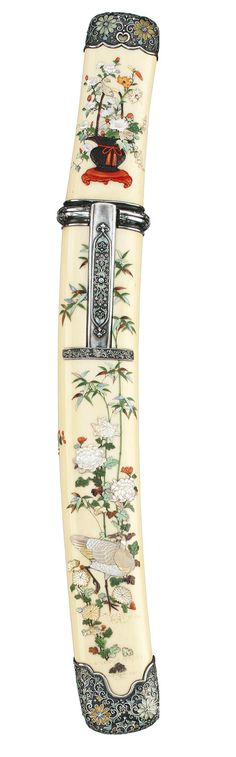 A Very Fine Shibayama Tanto Koshirae  Meiji Period (late 19th century)  Inlaid in mother-of-pearl, coral, tortoiseshell and stained ivory with a peacock in a blossoming tree, the hilt with a duck amongst flowers and the reverse with a basket of flowers, silver fittings finely carved and inlaid in coloured cloisonné enamels with flowers and scrolling foliage, containing a tanto blade with horimono of Jogeryu [ascending and descending dragons], gold clad habaki, Edo Period (19th century)