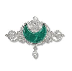 Anita Delgado ,BELLE EPOQUE EMERALD AND DIAMOND BROOCH   The crescent-shaped emerald within an old-cut diamond openwork surround suspending a marquise-shaped diamond, later brooch fittings, circa 1910. $78,500.00.