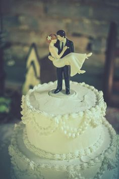 """Swept Up In His Arms"""" Cake Topper! Customize your own here: http://www.weddingstar.com/product/swept-up-in-his-arms-wedding-couple-figurine"""