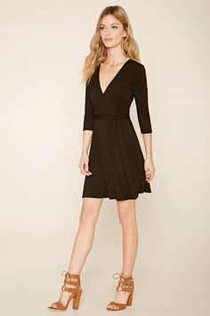 Forever 21 Contemporary - A knit dress with a surplice front forming a V-neckline, a removable self-tie sash belt, and 3/4 sleeves.