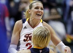 Katie Douglas, who led the Fever with 25 points, jumps into the arms of teammate Erin Phillips after Phillips hit a basket a the end of the second quarter during their win over the Liberty. Phillips also hit the game-winner for Indiana.  9/16/11