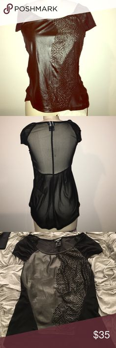 Bebe faux leather top Faux leather cap sleeved top with sheer back and sleeves. It is also sheer in the front where the perforated leather is. So cute with leggings ! bebe Tops