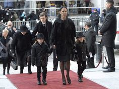 Grief-stricken: Celine Dion was joined by her three children. Older son René Charles, 14, escorted his elderly grandmother, Therese, into the service while Celine walked in gripping the hands of her twin five-year-old sons Nelson and Eddy
