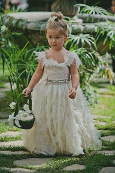45 Dreamy Outdoor Woodland Wedding Ideas | This feathery flower girl dress is perfection, and I can't get over her adorable moss-covered flower basket.