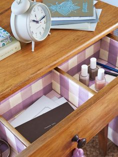 Get more mileage out of your favorite fabric by lining nightstand drawers with paper photocopies of the pattern. (Bonus: You can shrink or enlarge it as you see fit.) Measure drawers and cut shapes, then secure with double-sided tape.