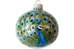 Gorgeous peacock in blue, white, black and green colors hand painted on the front of a glass Christmas ball ornament with acrylic paint and