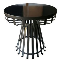 Handcrafted from wrought iron, this handsome design showcases a striking silhouette and slatted base. #jossandmain