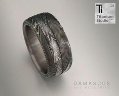 Titanium base ring with Damascus steel sleeve and Meteorite inlay