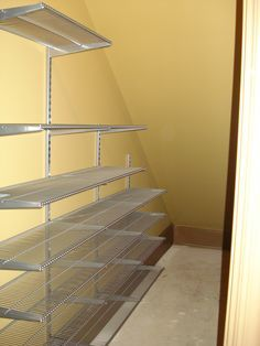 "The pesky under-the-stairs closet so may of us have. ELFA wall-mounted standards with 12"" deep shelving does the trick!"