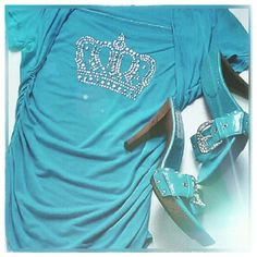 Blue studded crown shirt Super cute blue shirt with a shiny studded crown on chest, has elastic scrunching on both sides ,comfortable draping around neck and shoulders, worn once, no tags but fits like medium ,shoes sold in other listing, bundle for discount bebe diva  Tops Blouses