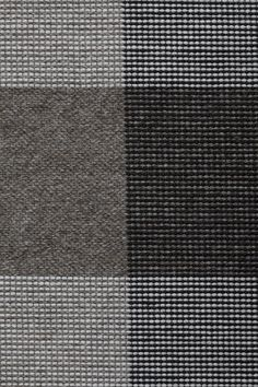 Foster in Black - Undyed Loam and Thin Felted Black - Customizable with all yarn colors. Foster is a tonal interplay of toothy weaves in an elegant gingham check pattern. A flatweave rug made from undyed heathered and felted wools, Foster is available in 3 rich colorways: Black, Midnight and Wisteria. The last mill built during Fall River's textile boom, The Foster Spinning Company was added to the National Register of Historic Places in 1983.