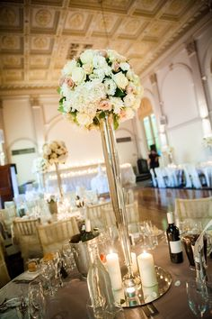 wedding centrepiece tall vase hydrangeas roses silver candles