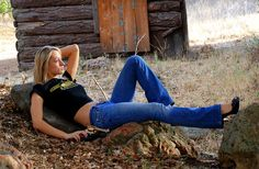 Beautiful Cowgirl Model with Two Colt 45 Revolver Guns.    She was pretty with blonde hair, wearing a cowboy hat and blue jeans!    A pretty woman on a beautiful country day, resting on a rock! With a cowboy hat!     Tips on how to (empower communications|video email|video presentation|video conference|your best internet video system|great biz opp) learn more on www.AV0409.iwowwe.com