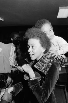 Poet Nikki Giovanni with her son Thomas on her shoulders <3