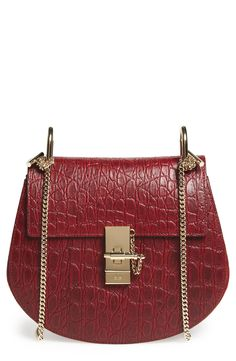 Free shipping and returns on Chloé 'Small Drew' Croc Embossed Calfskin Leather Shoulder Bag at Nordstrom.com. This sienna-red calfskin leather bag is beautifully highlighted with croc embossing and suede side panels in the same rich hue. Gleaming goldtone hardware sets off the compact saddle bag that's detailed with a suede-lined interior and distinctive squared-off flap.