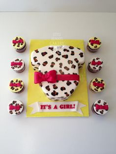 Cheetah print leopard print fondant onesie cake with matching cupcakes