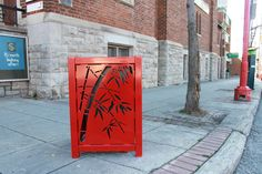 This beautiful bright custom design can be seen in China Town in Ottawa Ontario. #Maglin's MLWR400-25-M metal trash receptacle with the laser cut bamboo.