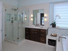Designer Carla Aston gave this master bathroom a contemporary design that also makes the room appear more spacious and offers a calm, spa-like effect.