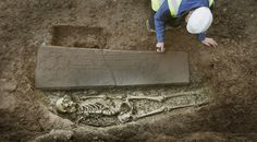 Edinburgh, 13th century. A knight with a richly carved sandstone slab marking his high rank and likely profession.