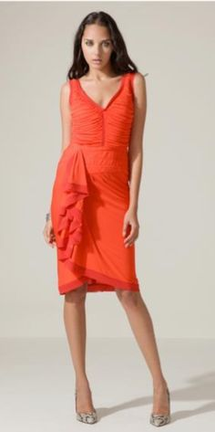 Zac Posen knows how to cut a dress for a feminine shape. Love the color and the Spanish inspired ruffles!