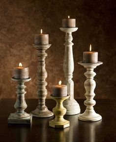 Kanan Wood Candleholders In Distressed Finishes - Set of 5 - With neutral color and soft distressing, the set of five Kanan wood candleholders are a tasteful choice adding ambiance to a room. Cluster the candleholders of varying heights to add drama, or spread around the room. Hold pillar candles.