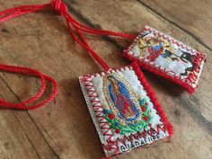 Metallic hand-stitched scapular with Catholic symbols. Often worn in Mexico to protect from bad omens. Wool backing and colorful cord. Perfect as bracelets, necklaces, or as gifts. Catholic Emboidered Symbols: Virgin del Guadalupe & Arch Angel Micheal