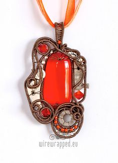 The focal cabochon is a beautiful handmade fused glass cab, that Ive bought from one of the glass artists here on Etsy. Its in a shade of vibrant orange,