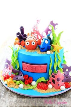 Vibrant under the sea #cake #fish #creative Bella Cupcakes