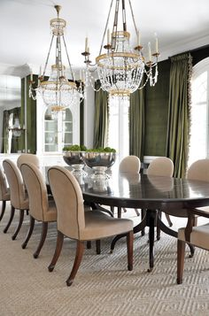 Dining room. moss green, glamorous chandeliers