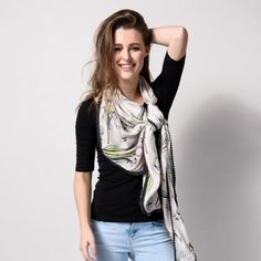 Pom Scarf Amsterdam Tulips 178 - A light cupro shawl with a printed design of typical Dutch elements. Different colour accents in green, yellow, rose and blue give this champagne-coloured shawl something special. The shawl is finishe