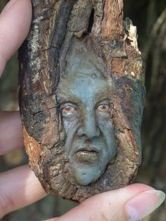 $59 sculpted clay face inside a piece of wood. $59? am I the ONLY one that thinks this is creepy!?
