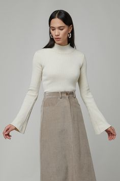 Reminiscent of the this ribbed mock neck sweater is designed with bell sleeves to add a feminine touch to any ensemble. Style yours with wide-leg corduroy pants to accentuate the vintage appeal. Oak And Fort, Ribbed Fabric, Corduroy Pants, Ribbed Sweater, Mock Neck, Wide Leg, Knitwear, High Waisted Skirt, Bell Sleeves