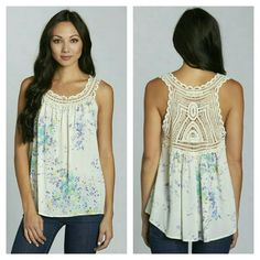 Printed Tank with Crochet Lace Yoke Vintage inspired floral printed tank with crochet lace yoke and an effortless fit. Exquisite Crochet Detailing. Fabric 100% Rayon Gauze