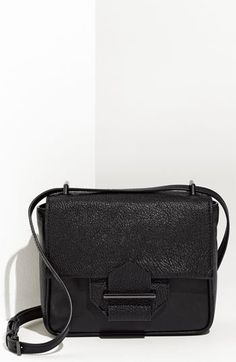 3400b21b80 Keep it classy with a black shoulder bag to carry your padfolio and water  bottle.