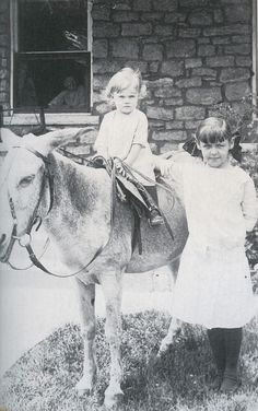 Ginger Rogers with Aunt Jean on a burro (Grandmother Saphrona Owens in the background in the window), 1914. Childhood Photos, Young Celebrities, Ginger Rogers, Celebrity Babies, Iconic Movies, Vintage Photographs, Vintage Photos, Oldies But Goodies, Edwardian Era