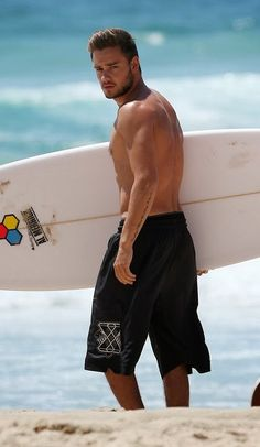 Liam Payne surfing on the Gold Coast of Australia on Oct. 21, 2013