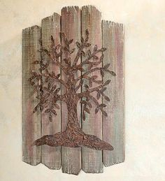 Tree Of Life Wall Art Accent by Plow & Hearth. $69.99. Rustic picket fence background. Tree of Life wall art accent. Wood and iron tree wall hanging for home decor. A natural and subtle accent for any room. Rich and rustic style works with any decor. Bring your walls to life with our rustic yet beautiful version of the classic Tree of Life. An iron tree rests on a wooden picket fence background with a natural look that works in any room. Makes a great housewarmi...