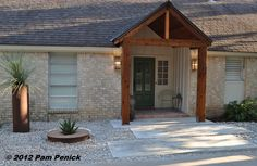 Floating concrete slabs, a gravel garden, and a new gable update the front of our traditional ranch.