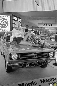 A model sits on a Morris Marina TC at the 1971 Paris Motor Show Jeremy Clarkson, Morris Minor, Citroen Ds, Lamborghini Gallardo, Audi R8, Porsche Boxster S, Morris Marina, Peugeot 204, Jaguar Type E