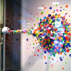 Skull spewing out colored paper squares in the Joe Jeans window in Santa Monica.